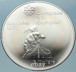 1974 CANADA Queen Elizabeth II Olympics Montreal Indian Canoe Silver Coin i82386