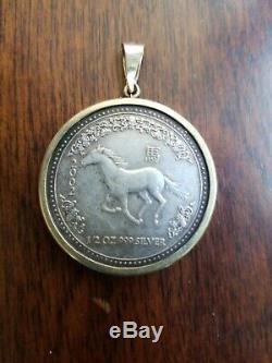 1/2 Ounce Silver. 999 Queen Elizabeth II Coin 2002 W 14 K Gold Bezel 50 Cents