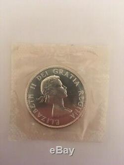 Uncirculated/sealed 1961 CANADA Queen Elizabeth II Canoe silver dollar